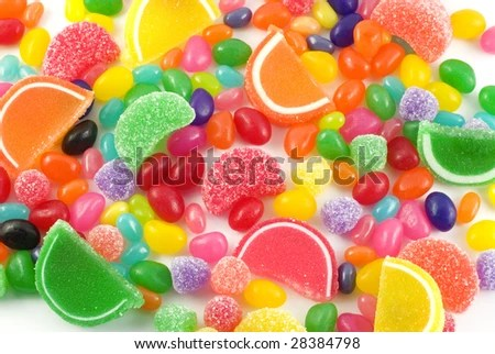 stock photo : An assortment of colorful candy on full frame background with jellybeans, gumdrops and other jelly candies