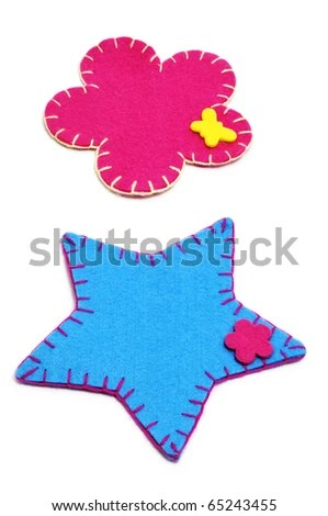 stock photo : a pair of fabric christmas ornaments on a white background