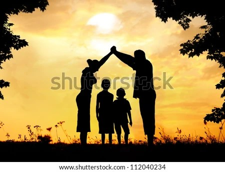Happy family with dream house - stock photo