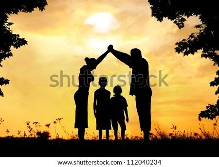Happy family with dream house - stock photo