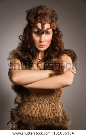Young woman in a fur suit of the amazon - stock photo