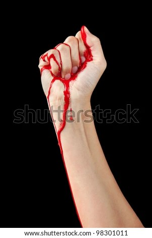stock photo : A red paint soaked hand making a fist isolated on black.