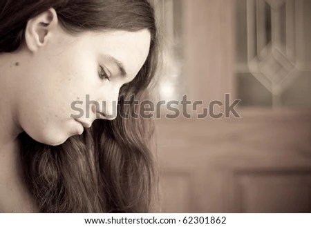 Age Portrait of Lady Looking Down in Deep Thought - stock photo