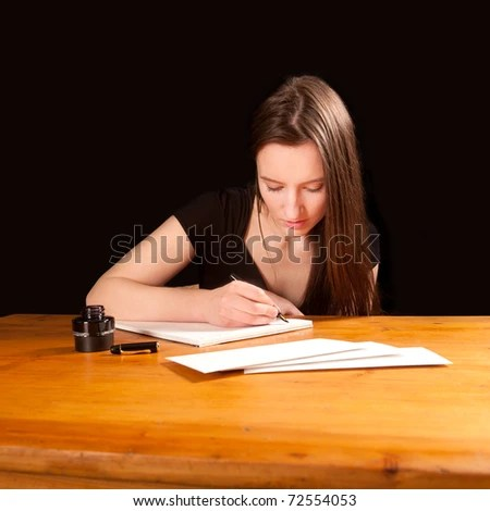 stock photo : Pretty young woman writing a letter at an old table