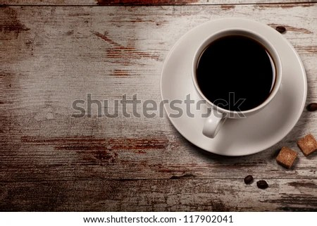 cup of black coffee over grunge wood