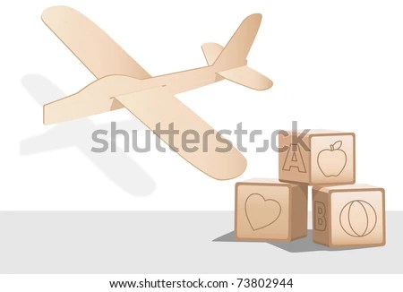 Balsa wood toy airplane and wooden baby building blocks. - stock