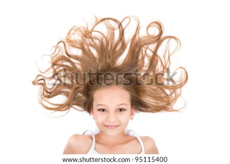 high angle portrait of the pretty young teenage girl with beauty long curly hair lying on the