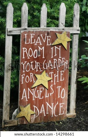 """sign saying """"leave room in your garden for the angels to dance"""" - stock photo"""