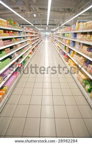 stock photo : Wide perspective of empty supermarket aisle