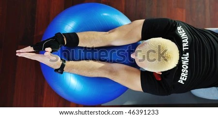 stock photo : man fitness personal trainer in sport club
