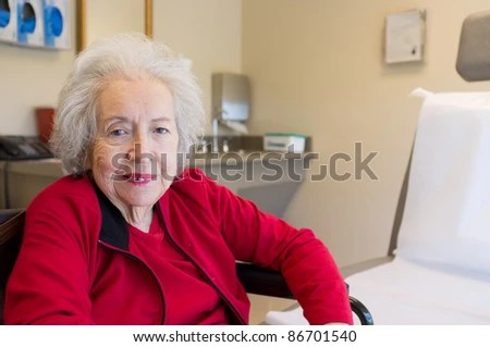 stock photo : Elderly 80 plus year old woman with Alzheimer in a medical office setting.