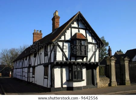 stock photo : Medieval Tudor age long house of black beam timber and whitewash photographed against blue sky. Oxfordshire England