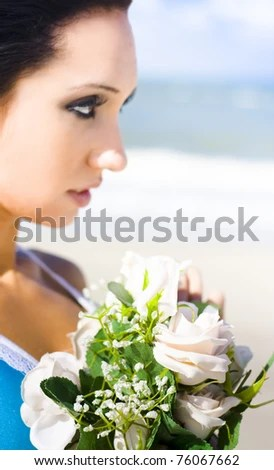 stock photo : Beautiful Summer Girl Smiling Outdoors With A Bouquet Of Light Pink Roses In A Thoughtful Kind And Caring Conceptual Of Giving And Receiving A Gift Of Love