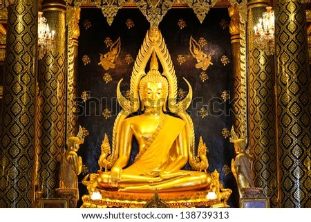PHITSANULOK,THAILAND-MAY 11:The beautiful ancient Buddha over 200 years(Phra Buddha Chinnarat)wait for Thai people to worship at Phra Si Rattana Mahathat temple on May 11,2013 in Phitsanulok,Thailand. - stock photo