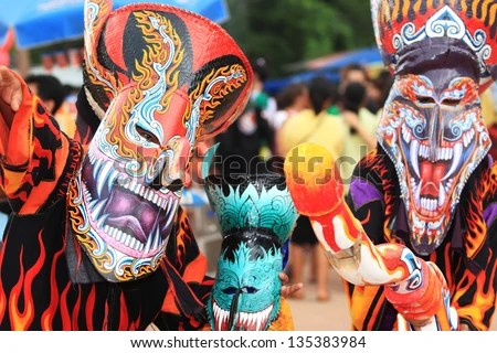 LOEI, THAILAND - : Phi Ta Khon Festival on June in Loei, Thailand. Young people dress in spirit and wear a mask, sing and dance - stock photo