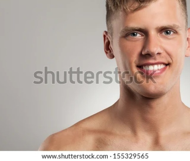 Portrait Of Handsome Naked Caucasian Guy Over Grey Background