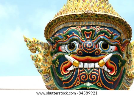Statue the face giant at Wat Phra Kaew in Bangkok, Thailand