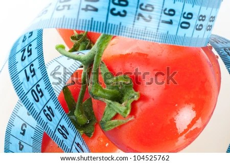 stock photo : tomato with measurement isolated on white