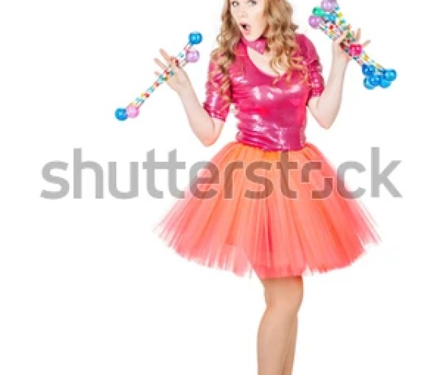 Dancing Blonde Schoolgirl Wearing In Pink Costume Dancing Woman Looking At Camera And Holding Accessory