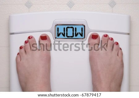 stock photo : Digital Bathroom Scale Displaying WOW Message