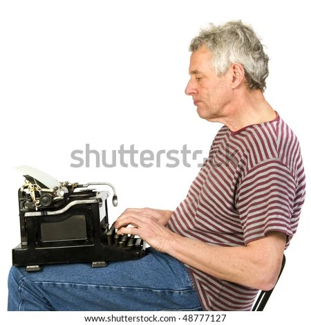 stock photo : Elderly man is writing a letter on a old black typewriter