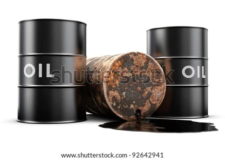 A leaking oil barrel spilling oil on the floor - stock photo