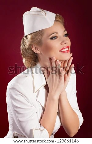 Beautiful Blonde Woman Stewardess Or Sailor In Marine