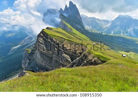 Odle mountains chain separating the  Funes valley from the Gardena valley, taken from the Seceda refuge, Italian alps - stock photo