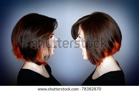 A young woman in a fight with herself - inner struggle. - stock photo
