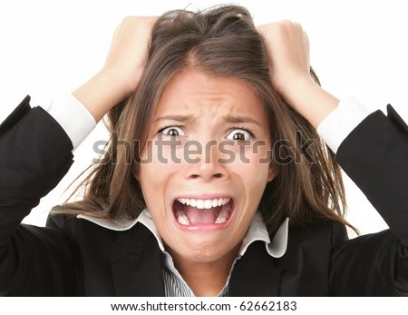 Stress. Woman stressed is going crazy pulling her hair in frustration. Close-up of young businesswoman on white. - stock photo