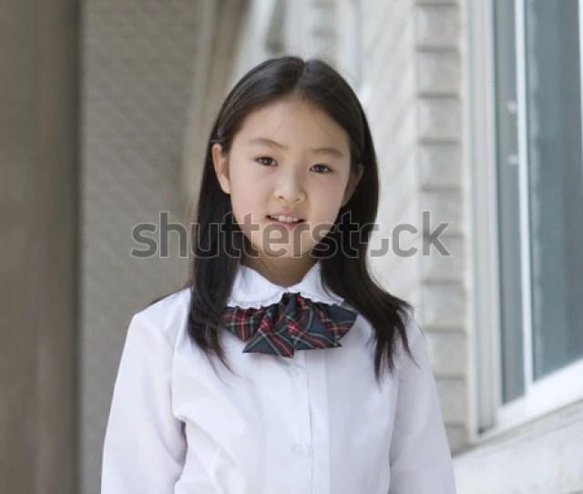 9 Year Old Asian School Girl In School Uniform