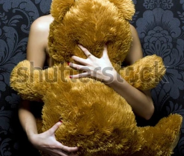 Beautiful Naked Girl Is Holding Th Teddy Bear