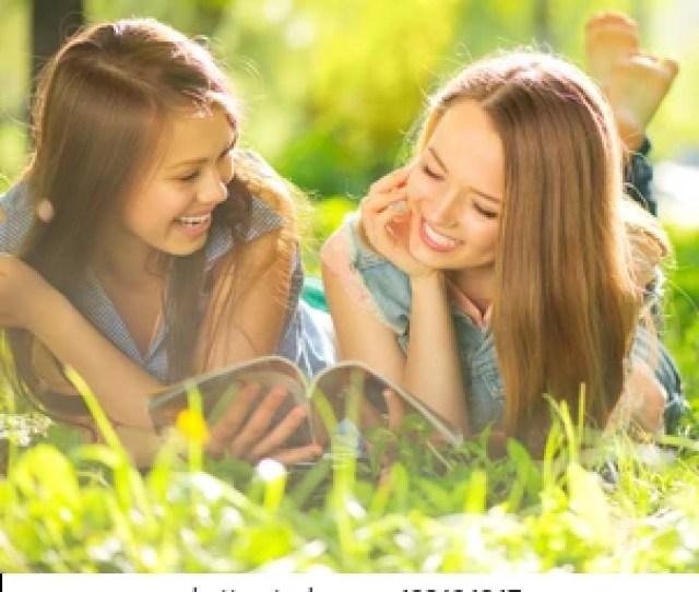 Beauty Teen Girls Reading Magazine And Having Fun Outdoors Beautiful Joyful Teenagers Lying On Spring