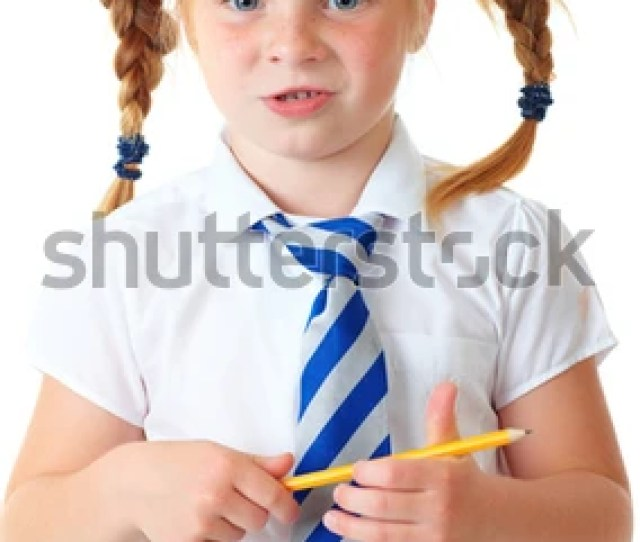 Blonde Schoolgirl In White Shirt And Blue Necktie Holds Yellow Pencil Shoot Over White Background