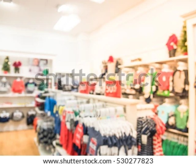 Blurred Children Clothing Store With Discount Sign And Variety Of Clothes For Newborn Kids