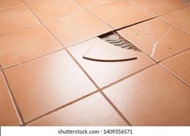 https www shutterstock com image photo broken tiles on tiled floor 1409356571