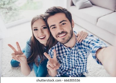Cheerful Playful Sister And Brother Are Taking Selfie And Showing Peace Signs They Are At
