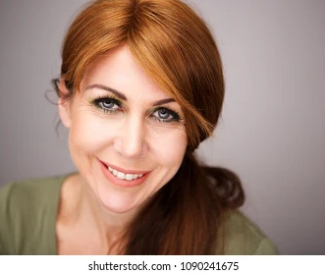 Close Up Portrait Of Beautiful Mature Woman Face With A Smile