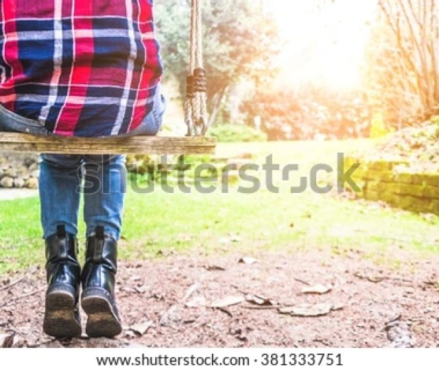 Closeup Of A Girl Sitting On A Swing Lifestyle People And Outdoor Concept