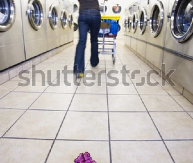 Closeup Of Panties Left On The Floor In Self Service Laundry