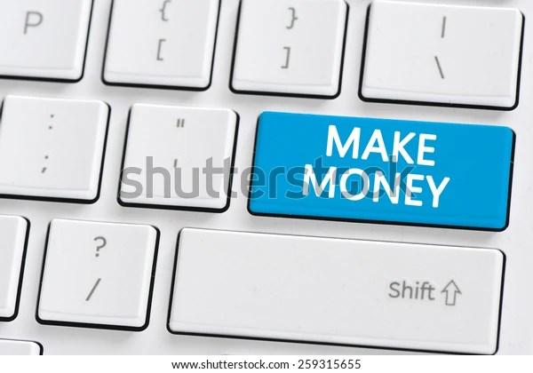 Computer keyboard with make money wbuton. Computer keyboard with make money button concept