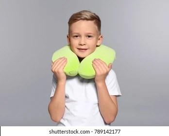 https www shutterstock com image photo cute boy travel pillow on grey 789142177