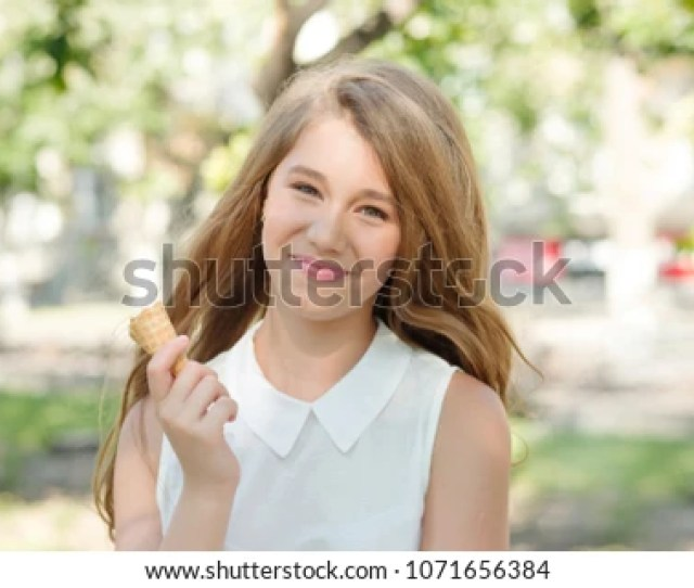 Cute Teenager Blonde Woman Teen Girl Holding Ice Cream Cone Smiling Happy In The