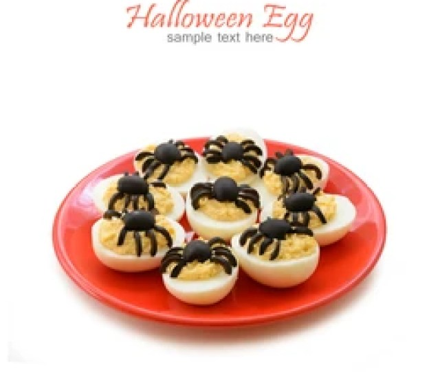 Deviled Eggs With A Olive Spider For Halloween Day On The White Background