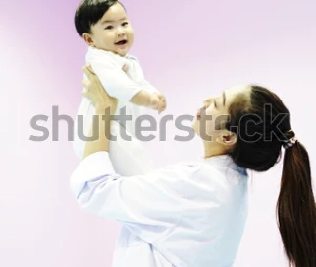 Doctor Carry Baby In Hand Lift Overhead Closeup Infant Baby In Mother Arms Happy