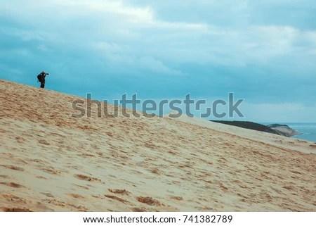 dune du pilat with photographer at sunset autumn season travel destination vacation bordeaux southern