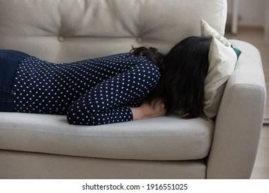 https www shutterstock com image photo exhausted millennial woman bury head pillow 1916551025