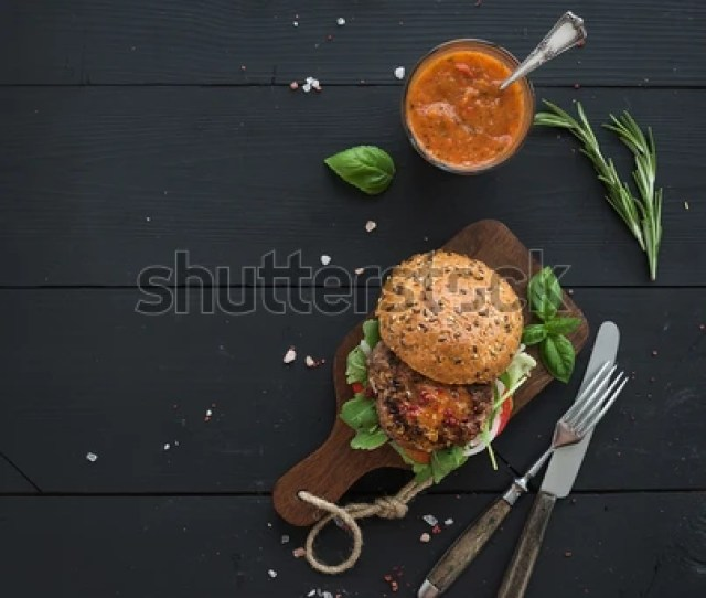 Fresh Homemade Burger On Dark Serving Board With Spicy Tomato Sauce Sea Salt And Herbs