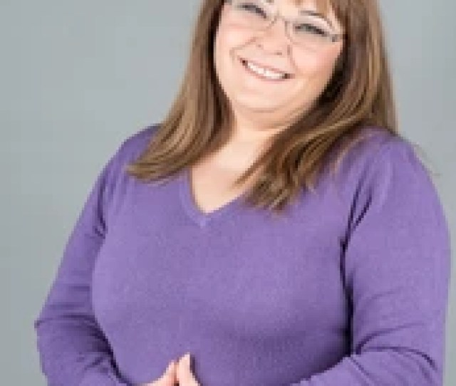 Happy And Chubby Woman With Glasses Smiling