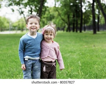 Happy Sister And Brother Together In The Park